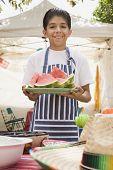 Hispanic boy holding plate of watermelon