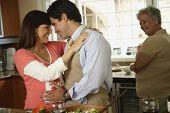Pregnant Hispanic couple hugging