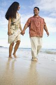 picture of pacific islander ethnicity  - Pacific Islander couple walking on beach - JPG