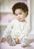 African baby wearing pajamas