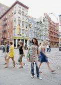 Mixed Race woman standing on urban sidewalk