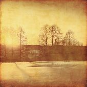 Winter landscape at sunset in grunge and retro style.