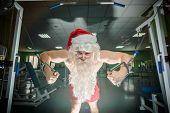 foto of gym workout  - Bodybuilder Santa on workout in a gym - JPG