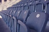 picture of bleachers  - Grey bleachers in an empty stadium on a sunny day - JPG
