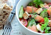 Salad with fresh vegetables and salmon