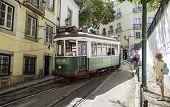 Lisbon, Portugal - September 19, 2014: Tram In Narrow Street Of Lisbon. Tram Is The Symbol Of The Ci