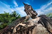 stock photo of religious  - Amazing view of mythology and religious statues at Wat Xieng Khuan Buddha park - JPG