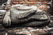Ancient Sandstone Sculpture Of Buddha At Wat Mahathat Ruins. Ayutthaya, Thailand Travel Landscape An