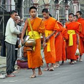 Buddhist Monks At Morning Collecting Food Donation. Huay Xai, Laos