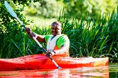 pic of canoe boat man  - African Man paddling with canoe on forest river - JPG