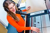 female Presenter in radio station hosting show for radio live in Studio
