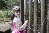Little Girl In Her Princess Costume Playing A Giant Xylophone
