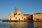 stock photo of michel  - View from the Venice lagoon of the church of San Michele in Isola on the cemetery island of San Michele at sunset Venice Italy - JPG