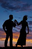 Silhouette Copule Hold Hands Sunset Look Away