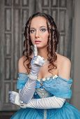 picture of dress-making  - Portrait of young beautiful medieval woman in blue dress making silence gesture - JPG
