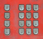 picture of dial pad  - orange phone with black key pad in Thailand - JPG