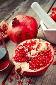 Pomegranate, Juice In Glass, Mortar And Pestle On Wooden Table