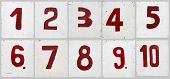 number set on white plywood board