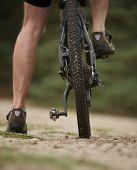 Rear View Low Angle Man Legs On Mountain Bike