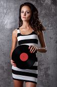 Music. Young dj with beautiful body