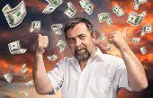 Man And Rain Of 100 Dollar Bills
