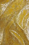 Golden Christmas fabric background with wrinkles and texture
