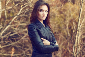 image of jacket  - Portrait of young beautiful woman in leather jacket - JPG
