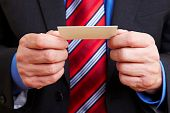 Hands Holding Business Card