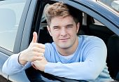 Attractive Young Man Sitting In His Car With Thumb Up