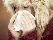 Sick Woman Sneezing In Tissue Outdoor
