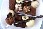 Dentist tools with sweets on plate close up