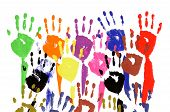 stock photo of untidiness  - Classroom concept pattern of child handprints made from vivid acrylic paint isolated on a white paper background - JPG