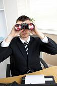 Caucasian Young Businessman Looking Through Binoculars
