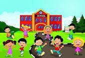 Happy school children cartoon in front of school