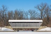 image of blanket snow  - The New Brownsville Covered Bridge is seen here blanketed in winter snow - JPG