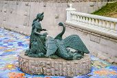 Young Lady And Swan Sculpture In Moscow