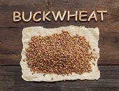 stock photo of buckwheat  - Buckwheat and a word Buckwheat on a wooden table - JPG