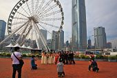 HONG KONG, DECEMBER 11, 2014: Hong Kong Special Administrative Region. The modern city on the ocean coast. Youth wedding photographed next to a huge ferris wheel