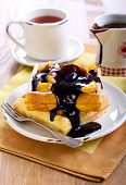 Waffles With Fruits And Chocolate Sauce