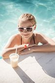 Little Blond Girl With Cocktail In Swimming Pool