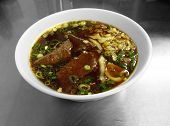 stock photo of chive  - Braised beef in broth with thick noodles and chives is a popular dish in Taiwan - JPG