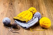 stock photo of knitted cap  - ball of threads and knitting caps on wooden background - JPG