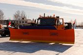NIZHNY NOVGOROD. RUSSIA. FEBRUARY 17, 2015. The SCHMIDT snowplow cleans the road from snow