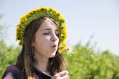 Girl Blowing A Dandelion