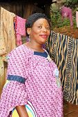 picture of overpopulation  - Portrait of a pregnant black African woman in her backyard - JPG