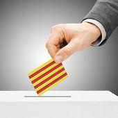 Voting Concept - Male Inserting Flag Into Ballot Box - Catalonia