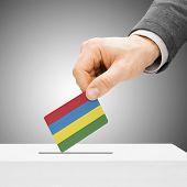 Voting Concept - Male Inserting Flag Into Ballot Box - Mauritius