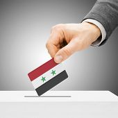 Voting Concept - Male Inserting Flag Into Ballot Box - Syria