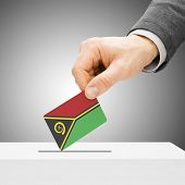 Voting Concept - Male Inserting Flag Into Ballot Box - Vanuatu