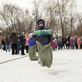 Boys Sack-racing During Winter Maslenitsa Carnival In Russia